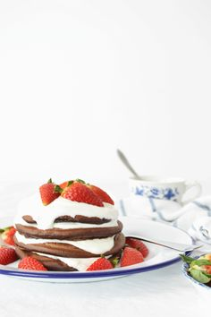 Healthy Carob Pancakes with Greek Yoghurt and Strawberries for breakfast. Click to read more or pin and save for later!