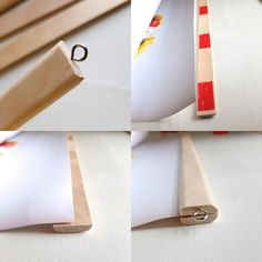1. Screw in eye screws to each end of ONE piece of wood, reserve for top front. 2. Place pieces of tape across one of the wood strip and remove backing. 3. Carefully place top of poster to align half way down tape. The tape is really strong so be careful to get it right the first time as repositioning may tear poster. 4. Position wooden piece with eye hooks on top and press firmly.  DIY POSTER HANGER!