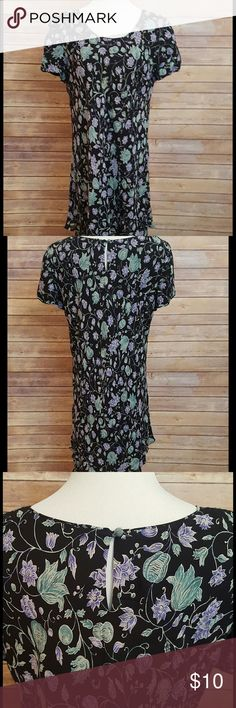 Floral Dress Beautiful floral dress with short sleeves; black/green/periwinkle. Cute tiered ruffles at bottom,  comes to mid-calf. This is a re-Posh...unfortunately it did not fit me right.  Perfect for any occasion! In excellent condition. Photos from original post. Liz Claiborne Dresses Mini