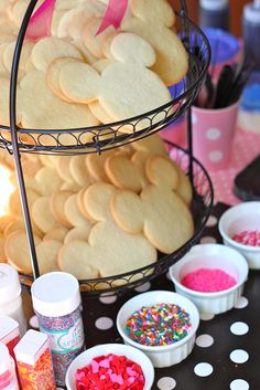 "A ""decorate your own sugar cookie"" station for a Minnie Mouse party."