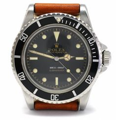 Portrait of a gorgeous 1959 Rolex Submariner. (Just in case you ever wonder what to get me for my birthday ...) Sexy!