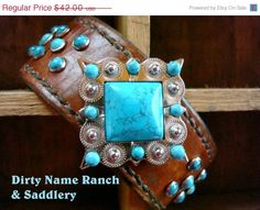 ON SALE Hand-stitched leather cuff featuring turquoise rivets and large 2 inch concho featuring large faux turquoise stone