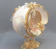 cloud eggs Cherub are playing in the clouds inside this diorama featuring fluffy clouds. This cherub diorama makes a beautiful, keepsake topper for your wedding cake. Created from a hand c Diorama, Egg Crafts, Easter Crafts, Pearl Paint, Hanging Crystals, Faberge Eggs, Princess Aesthetic, Egg Art, Egg Decorating