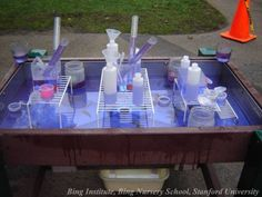 Water table with cups, tools on dishwasher racks (Bing Nursery School, Stanford University)