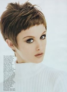 Short pixie haircut with face-framing fringe