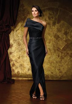 One-shoulder organza and lace sheath with wide dramatic asymmetrical neckline, single short sleeve, lace bodice with hand-beaded natural waist, asymmetrically pleated organza tulip skirt with slight high-low hem, detachable sweep train.
