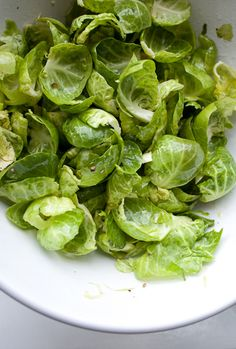 Brussels Sprout leaves    Ingredients:  1 pound Brussels Sprouts  3 tablespoons olive oil  ½ teaspoon salt  ½ teaspoon pepper  Juice of half a lemon  Zest of one lemon  ¼ cup grated Parmigiano Reggiano