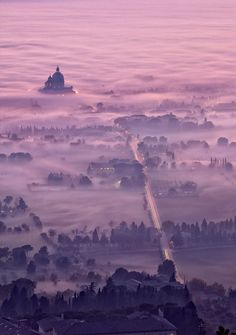 Assisi at foggy dusk, Perugia, Italy