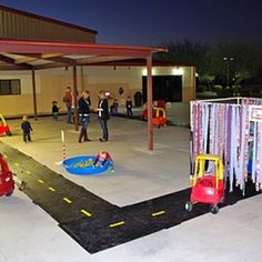"Race Trac: with Pit stops. I think any little friends would love the ""car wash"" streamers and the ball pit! Race Car Birthday Party"