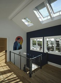 Natural light from skylights, an iron bannister, and pop art brings modern edge to this upstairs hallway. Wall Design, House Design, Upstairs Hallway, Master Bedroom Closet, Bannister, Skylights, Smart Home, Small Living, Natural Light