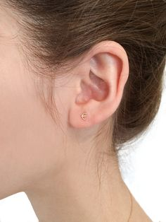 Currency Stud (Euro), 14k gold, $66.