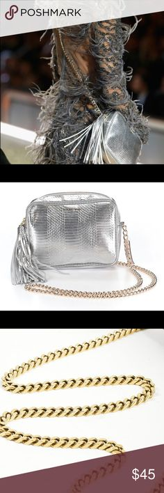 NWT VICTORIA SECRET metallic crossbody NWT ACTUAL VS metallic RUNWAY crossbody bag with heavy metal chain. Measures 8x6x2. Beautiful bag! Perfect for a night out or everyday use. Everything in perfect condition including the tassel! Victoria's Secret Bags Crossbody Bags