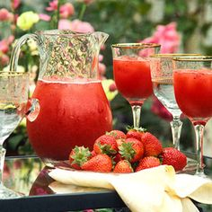 Strawberry daiquiri punch.  Just four ingredients and ice cubes make a delicious summer punch. Make a nonalcoholic version by choosing the pineapple juice instead of rum.