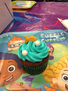 Bubble guppies cupcakes: chocolate cupcake with vanilla buttercream frosting. Teal food coloring and white chocolate to resemble bubbles .