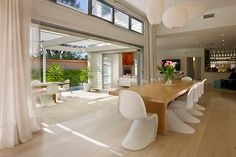 inspired light and bright manly beach house with verner panton chairs george nelson kartell fly suspension maps shades designed by ferruccio laviani - Beach House Design 1950s