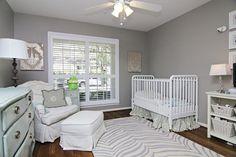 Cute neutral nursery idea. Love the zebra rug.