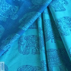 Didymos India pattern in stunning Turquoise and Blue wool.Wooloffers great cushion, support and supreme softness