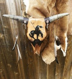 This hand-painted cow skull is perfect for a western or Native American themed…