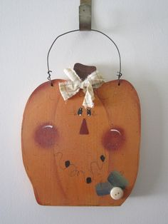 wood pumpkin painted face wall decor by simplysueellen on Etsy, $10.00
