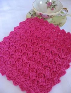 Tulip Stitch Dishcloth - Crochet Size: 8 in. x 8 in. Materials: 1 ball worsted cotton yarn Size G crochet hook or size needed for a fairl...
