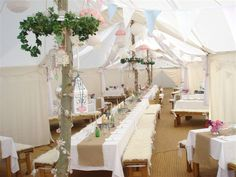 the inside of a wedding party tent at the globe from Tents 4 Elements
