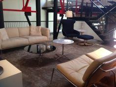 Upper living area, Sofa and all chairs by Living Divani; tables by Living Divani. Lighting by Pallucco, rug by Kymo.