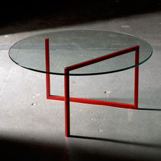 "Faktura SNAKE round coffee table •description/ A single sleek line powdered-steel frame slithers under this coffee table's top for a seamless contemporary look. This design can also be adapted for a side table and even dining table. •dimensions/ 30""x30""x13"" •materials/ powder coated steel frame & glass top"