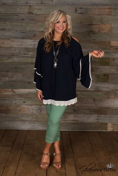Sweet Moments Top is so sweet! This navy peasant style top has a round neckline with gathered detail around the yoke.