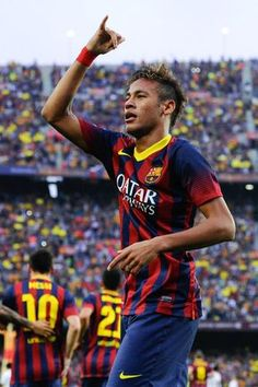 Neymar of FC Barcelona celebrates after scoring the opening goal during the La Liga match between FC Barcelona and Real Madrid CF at Camp Nou on October 26, 2013 in Barcelona, Catalonia.