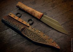 A little composite pattern welded seax I made for a conference I demonstrated at in Oakland California (The Oakland Axe 'n Sax-in) I forged the blade and made the grip before going and constructed the sheath at the conference. the designs on the sheath are based on some late viking age sheaths found in York in Northern England. Designed and created by Jake Powning.