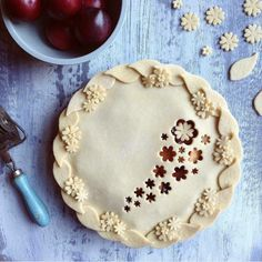 Decorative pie crusts: leaves and flowers around edge of pie with flower cut outs in middle