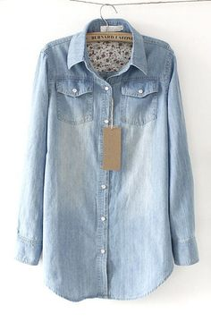 {light blue denim shirt with pearly buttons}
