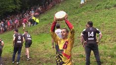 WATCH: The Cooper's Hill Cheese-Rolling, in Gloucestershire, UK, is an unusual—and surprisingly dangerous—annual athletic challenge. People Of The World, Uk People, Gloucester England, King Of The Hill, Cheese Rolling, World Famous, National Geographic, The Locals