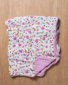 """- Description - Product Details - Material and Care Snuggle x 4. Naturally soft and breathable quilts made with four layers of our organic cotton. • 47"""" x 47"""" quilt • 4-layer 100% organic cotton musli"""