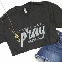 "On a heather charcoal with ""Hustle Hard Pray Harder"" design. FIT: Unisex - True to size. Size Bust/Chest Inches XS 30-32 Small 34-36 Medium 38-40 Large 42-44 XL 46-48"