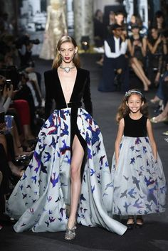 """Mommy and I walk down the runway in matching outfits."""