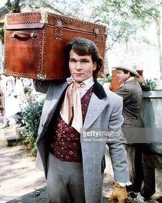 American actor Patrick Swayze carrying a trunk as Orry Main in the TV miniseries 'North And South' 1985 Parker Stevenson, Lisa Niemi, Civil War Movies, Jonathan Frakes, Patrick Wayne, Jennifer Grey, Dirty Dancing, North South, Dream Guy