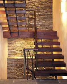 2005 Cambridge Project House: The show-stopping staircase, floating before a stacked stone wall that echoes the exterior chimney and foundation, has stair treads and railings made of reclaimed teak from pole buildings in Southeast Asia Wood Stair Treads, Wood Stairs, House Stairs, Stone Stairs, Basement Stairs, Floating Staircase, Modern Staircase, Staircase Design, Floating House