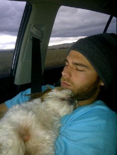 Brandon Crawford sleeping with a puppy. My heart cannot handle this.