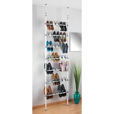 The Perfect solution for your shoe collection, this adjustable Atlas Telescopic Shoe Rack extends as your collection grows. The tension mount design makes it easy to install and it slides up and down to allow easy access to shoes. Diy Closet System, Shoe Rack Closet, Shoe Racks, Metal Shoe Rack, Clutter Control, Shoe Cabinet, Grey Bedding, Tool Organization, Master Closet