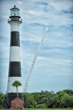 The last space shuttle launch and the Cape Canaveral AFS Lighthouse, Cape Canaveral, Florida Lighthouse Lighting, Florida Sunshine, Cape Canaveral, Photography Sites, Beacon Of Light, To Infinity And Beyond, North America, Photo Documentary, Scenery
