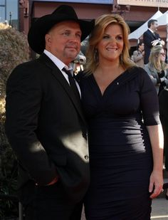 Trisha in Kiyonna's Plus Size Betsey Ruched Dress.  |  Garth Brooks and Trisha Yearwood attends the Country Music Hall of Fame Inductions on Sunday, Oct. 21, 2012 in Nashville, Tenn. (Photo by Wade Payne/Invision/AP)