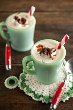 christmas cocoa in a jadeite mug with crocheted coaster.