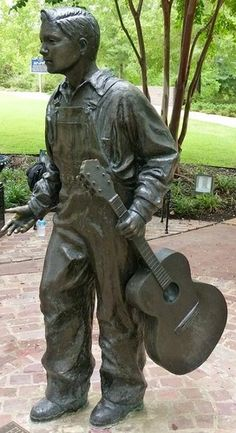 Statue of Elvis Presley at age 13, located in Tupelo, Mississippi