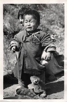 1951- Korean refugee child bursts into tears as a result of combined weariness, fear and hunger. He was one of the youngsters found when UN troops moved into the Hongchon sector of the central front in Korea.