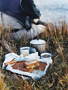 Winter picnic of cake and coffee by the sea