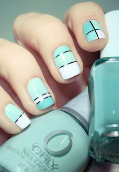 Thin strips of silver metallic foil in criss-crossing design adorn the sky blue and white ensemble of the manicure.