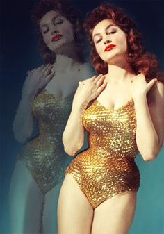 Julie Newmar 1960's Bombshell. If my waist were that tiny I'd strut around in a sequinned leotard too.