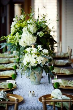 Lovely ~ The mini topiary place card holders are charming