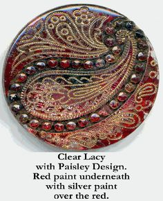 Lacy glass buttons were made at the end of the 19th and early part of the 20th century. A Lacy is a pressed transparent glass button with a fancy,  delicate design, usually characterized by fine stipling. In original condition, the back often has  colored, silver, or gold paint, usually coated over with black paint.